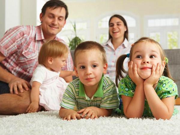 Happy family on carpet